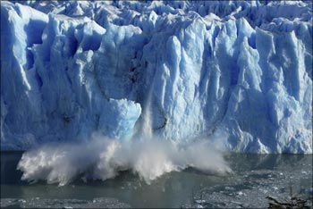 Splinters of ice peel off from one of the sides of the Perito Moreno glacier.