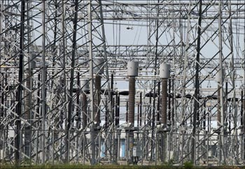 Power transmission lines are seen inside a power project at Kamrej, near Ahmedabad.