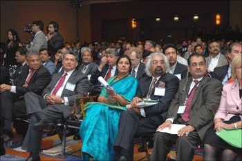 Daggubati Purandeswari, Minister of State for Human Resource Development, Rajat Gupta (L) and Sam Pitroda (R) at the PanIIT event.