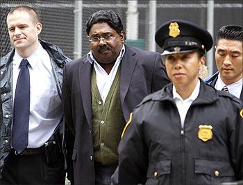 Raj Rajaratnam is escorted by FBI agents after being taken into custody in New York.