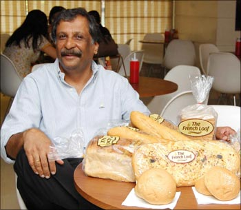 M Mahadevan with the goodies prepared at his Hot Breads bakery.