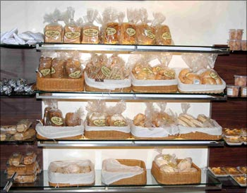 Some of the breads, pastries, etc on display at a Hot Breads outlet.