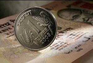 Indian rupee and a coin