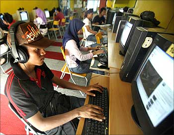 Internet users surf at a cyber cafe.