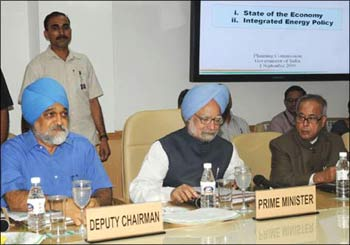 Prime Minister Manmohan Singh, Planning Commission Deputy Chairman Montek Singh Ahluwalia and Finance Minister Pranab Mukherjee at the Planning Commission meet in New Delhi on Tuesday.