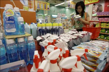 A customer looks at face masks in the anti-flu section at a supermarket in Taipei.