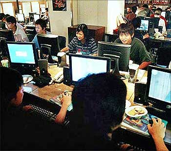 Teenagers play computer games in a Hong Kong Internet cafe.