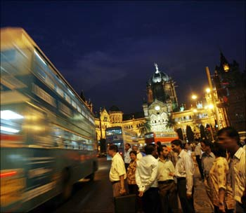 A double-decker bus goes past Chhatrapati Shivaji Terminus railway station in Mumbai.