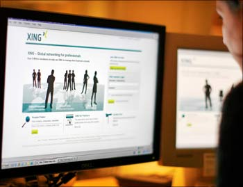A web-user views a global networking site called Xing in Stockholm.