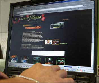 An employee of Philippine casino operator surfs the Internet.