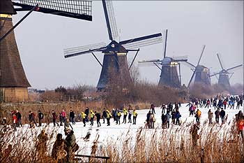 Skaters enjoy the scenery of windmills at the UNESCO World Heritage site in Kinderdijk, the Netherlands.