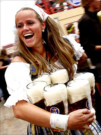 An Oktoberfest waitress carries beer after the opening ceremony of the Oktoberfest in Munich.