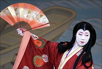 A geisha performs during an annual spring dance performance at a theatre in Kyoto, Japan.