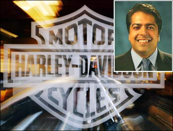 Motorcycle maker Harley Davidson's logo on the window of store in Boston. (Inset) Anoop Prakash, Managing Director, Harley-Davidson India.