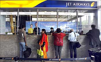 Passengers speak with employees at the Jet Airways ticketing counter at the domestic airport in Mumbai on Sep 8.