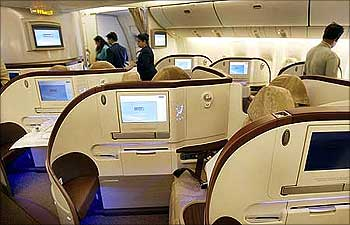 People look at the newly introduced premier class cabin in a Jet Airways Boeing 777-300.