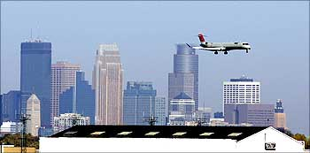 A Northwest Airlines jet lands at the Minneapolis St. Paul International Airport.