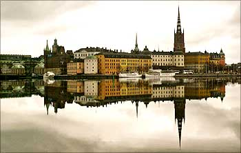 Stockholm's Gamla Stan or old town district is reflected in calm waters.