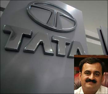 Outside a Tata Motors showroom (Inset) Pavan Duggal.