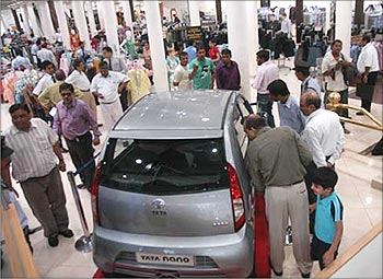 Customers take a look at the Tata Nano in Mumbai.