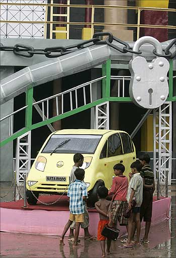 Children look at a replica of a Nano in a pandal in Kolkata during the Durga puja festival.
