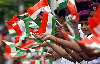 School children wave India's national flag during the Independence Day celebrations in Chennai.