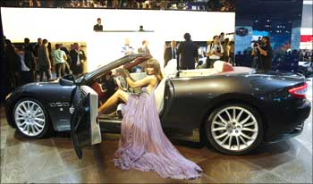 A model poses in the new Maserati GranCabrio.