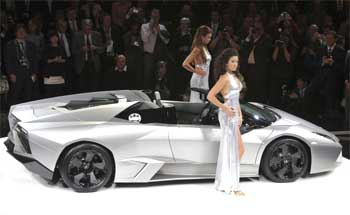 Models pose next to the new Lamborghini Reventon.
