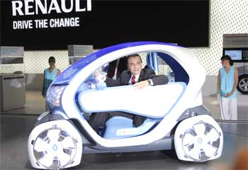 Carlos Ghosn, President and Chief Executive Officer of Renault sits in a Twizy Z.E. concept.