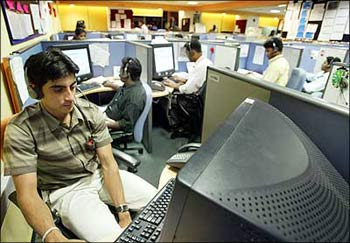 Workers at an Indian IT firm's office.