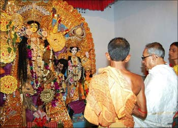 Finance Minister Pranab Mukherjee performing Durga Puja at Miriti, his ancestral village near Kirnahar in Birbhum district, 250 km from Kolkata.