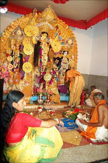 Pranab Mukherjee (extreme right corner) perfroming puja.