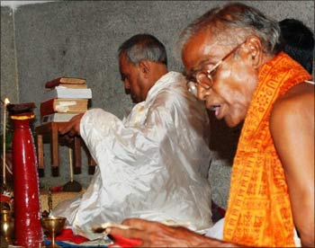 Pranab Mukherjee at the Puja pandal with another priest.