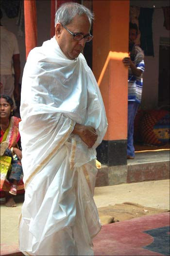 Pranab Mukherjee clad in a dhoti and uttoriyo for the puja.