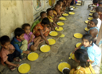 Students have a free meal distributed by a government-run school in Nalchar village, near Agartala.