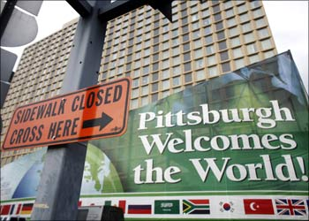 Signs are seen near the site of the upcoming G20 Pittsburgh summit in Pittsburgh, Pennsylvania.