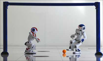 A robot gets ready to score a goal.