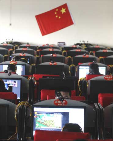 People use computers at an Internet cafe in Changzhi, Shanxi province, China.