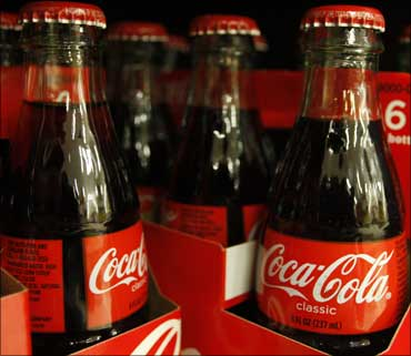 Bottles of Coca-Cola sit on a supermarket shelf in Gilbert, Arizona.