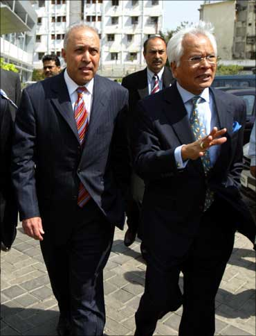 Former Vodafone CEO Arun Sarin (left) walks with former Hutchison Essar CEO Asim Ghosh in Mumbai