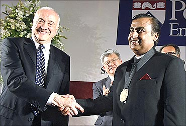 Mukesh Ambani receives the Dean's Medal from Eduardo Glandt, University of Pennsylvania's School of Engineering and Applied Science.