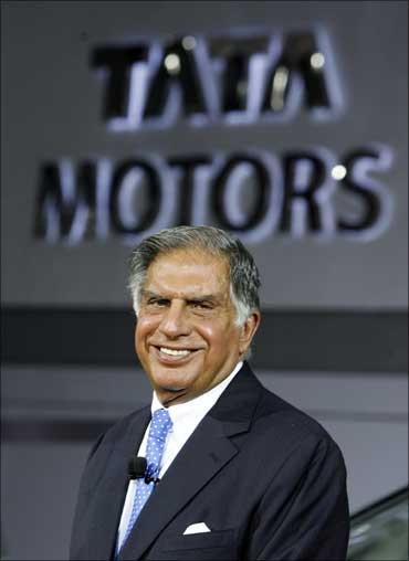 Tata Group chairman Ratan Tata smiles during the unveiling of Tata Motor's new car Aria at India's Auto Expo in New Delhi.