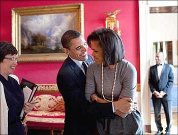 Image: Obama hugs his wife, Michelle, in the White House Red Room as Senior Advisor Valerie Jarrett smiles. Photographs Pete Souza/The White House/Handout/ Reuters
