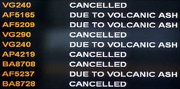 A screen informs passengers that all flights have been cancelled after ash from a volcanic eruption.