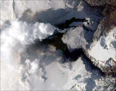 A volcanic fissure near Iceland's Eyjafjallajokull volcano sends a plume of ash and steam skyward.