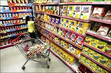A customer collects food packets at a shopping mall in Siliguri.