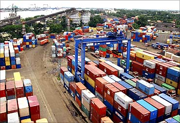 Shipping containers stand stacked at Cochin Port.
