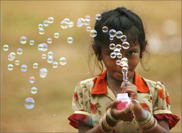 A girl selling bubble-making toys in Mumbai.