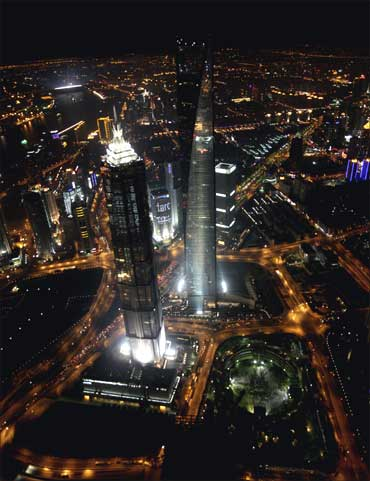 An aerial view of Shanghai's new financial district skyline along the Huang Pu river at night.