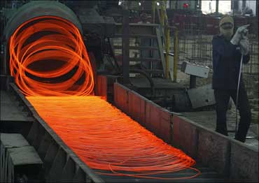 A labourer works inside a steel factory in Kanpur.
